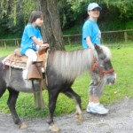 My daughter riding a pony