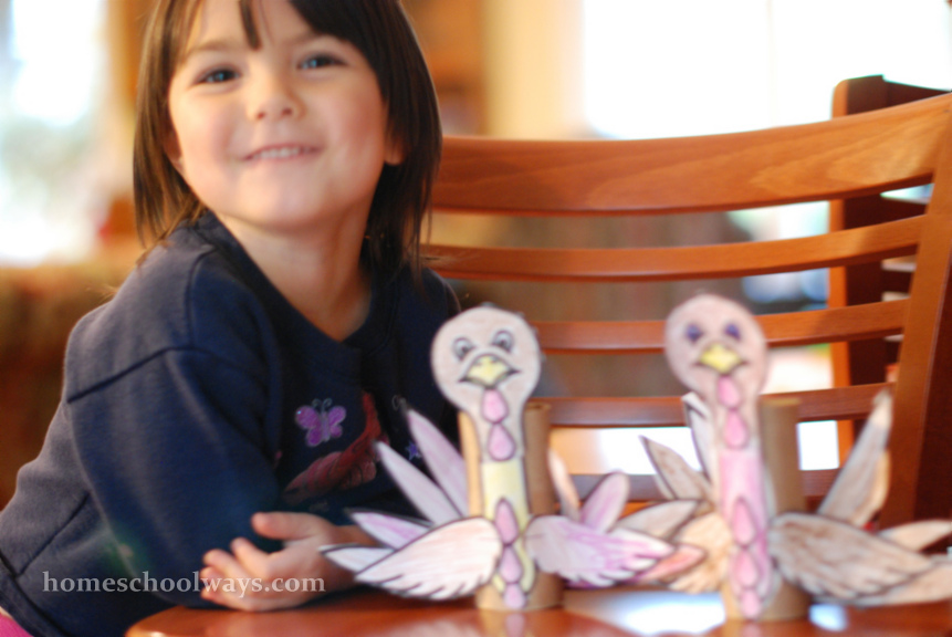 Little girl with Thanksgiving turkey crafts