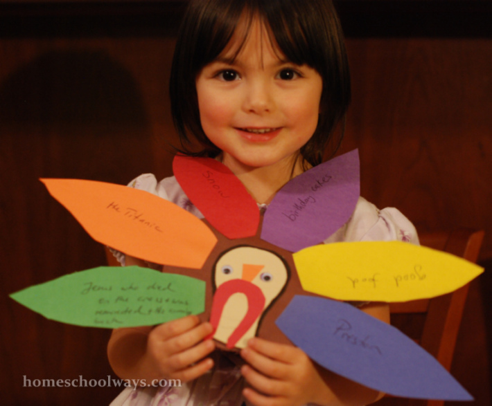 Little girl with Thanksgiving turkey craft