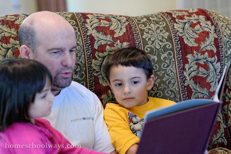 Dad reading to his son and daughter