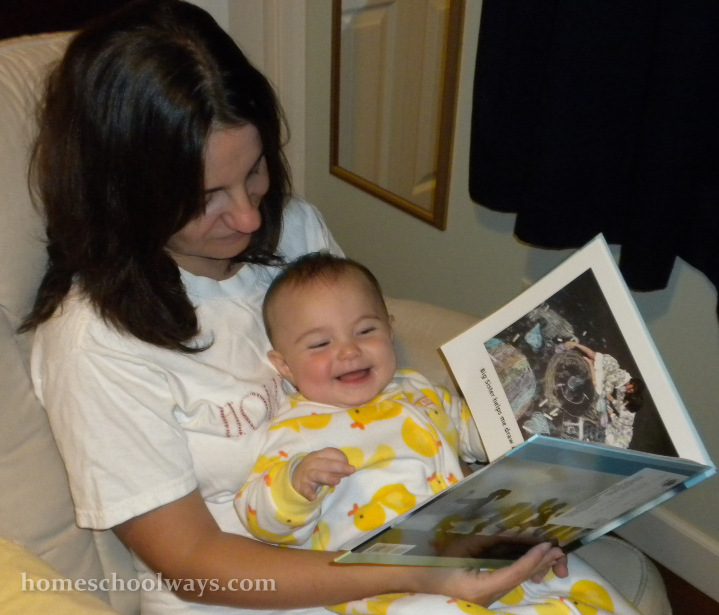 Mom reads to infant baby girl