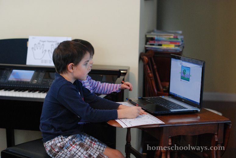 My children coloring a page as they follow instructions from Kinderbach.com - our piano curriculum online