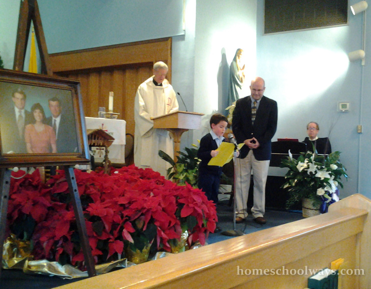 Six-year-old boy reading Psalm 23 at his grandfather's memorial service in a catholic church