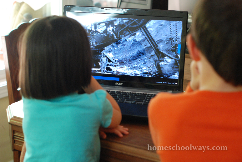 Children watching a documentary about steam shovels