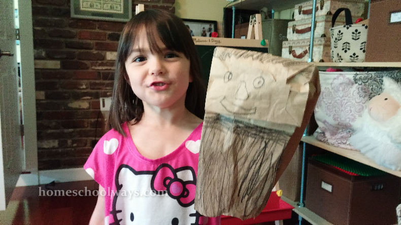 Girl with paper bag puppet