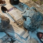 Newspaper crumpled up in a ball and glued together with wallpaper paste