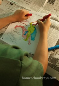 Boy coloring a picture of Alexander the Great