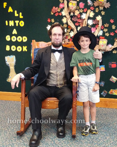 Boy with an actor impersonating Abraham Lincoln