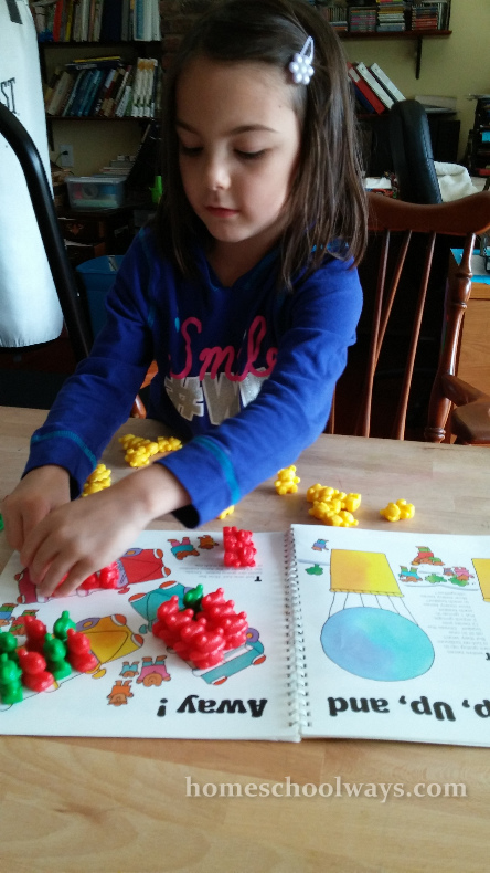Girl counting with math teddy bears