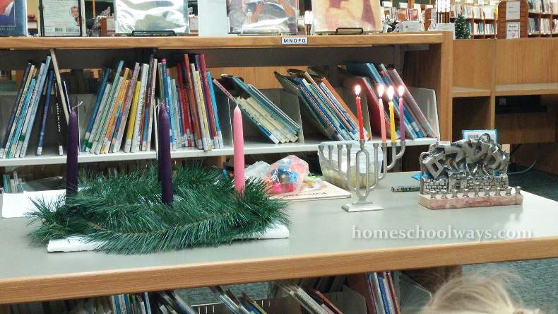 Advent wreath and candles next to a Hanukkah Menorah