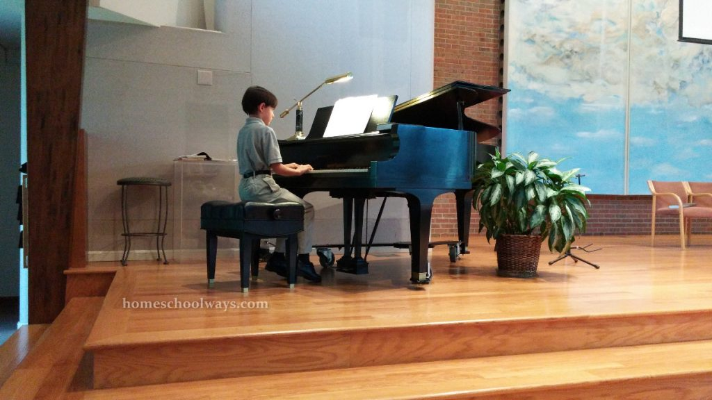 Boy playing piano in church