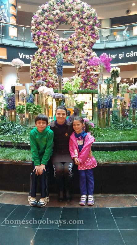 Aunt with nephew niece inside a Bucharest mall
