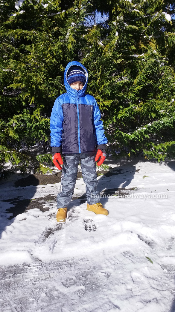 Boy dressed to play in the snow