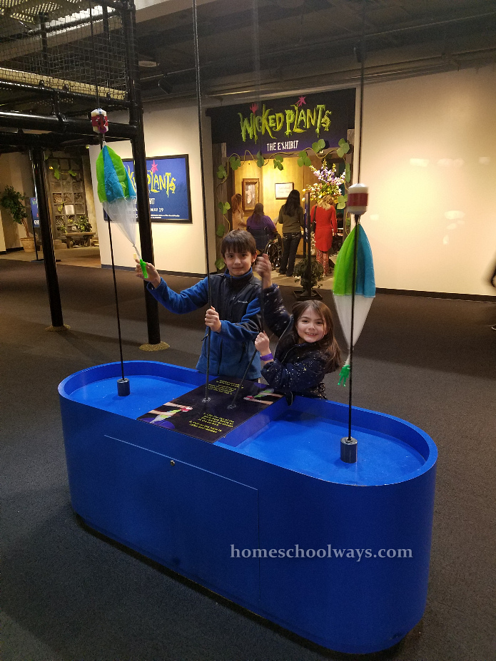 Boy and girl play at Adventure Science Center