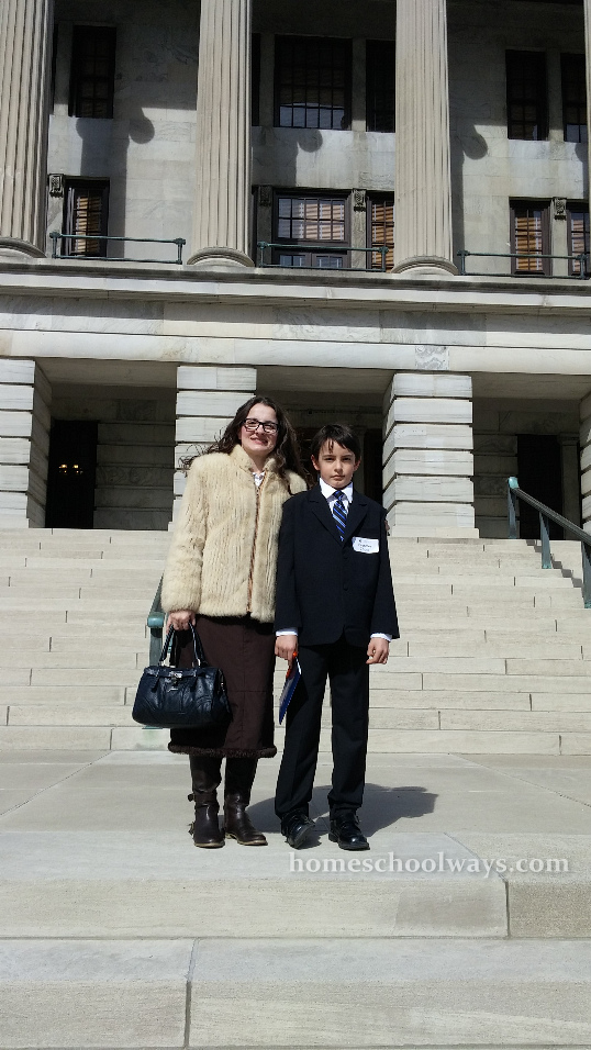 Mom and son in front of the Tennessee Capitol Building in Nashville.