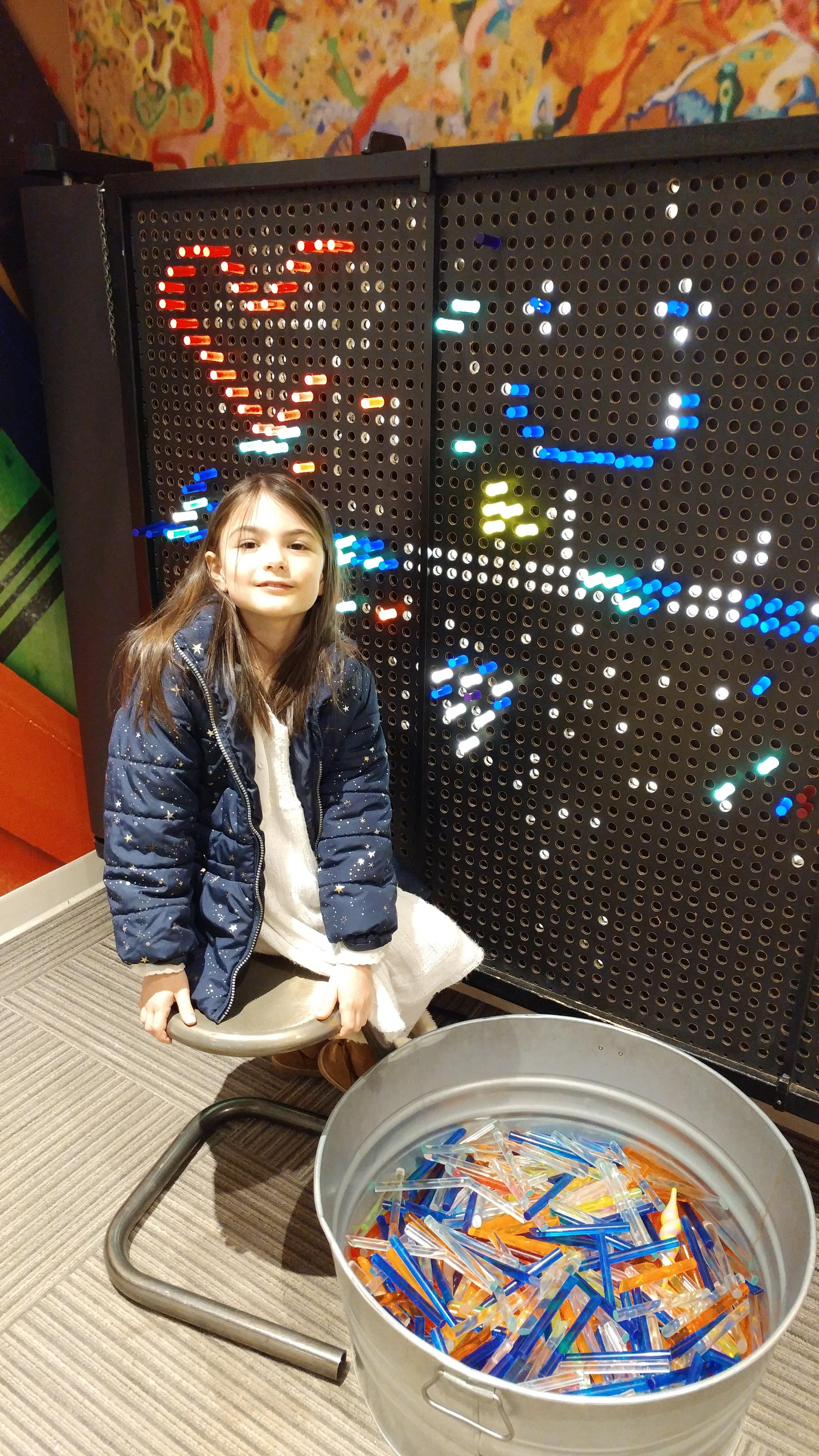 Girl at KMA Lite Brite Wall
