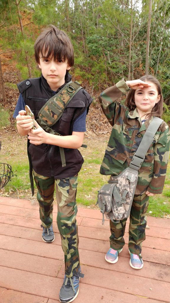 Boy and girl in camo
