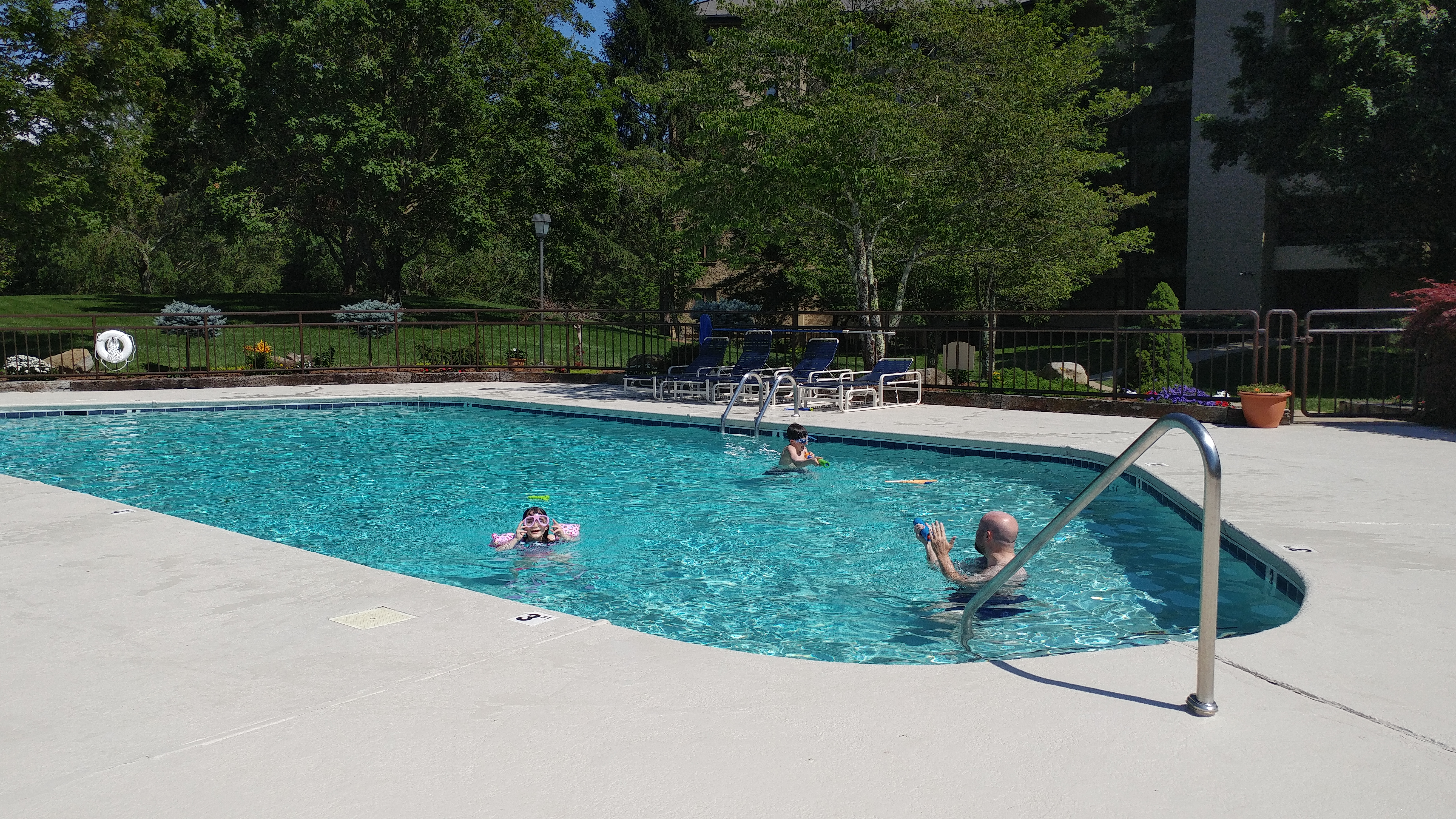 Father, daughter and son at the pool