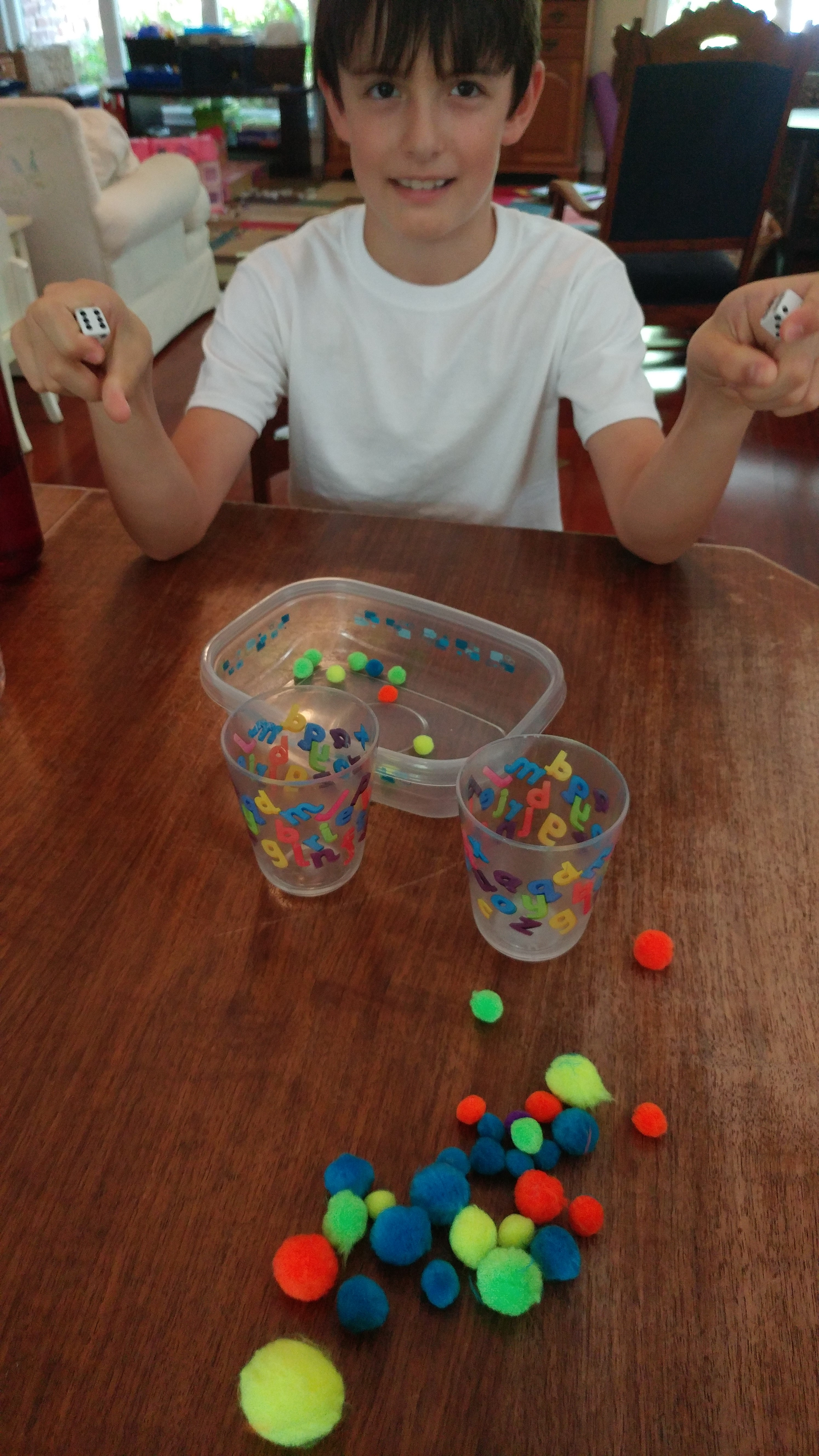 Shake and add with pom poms