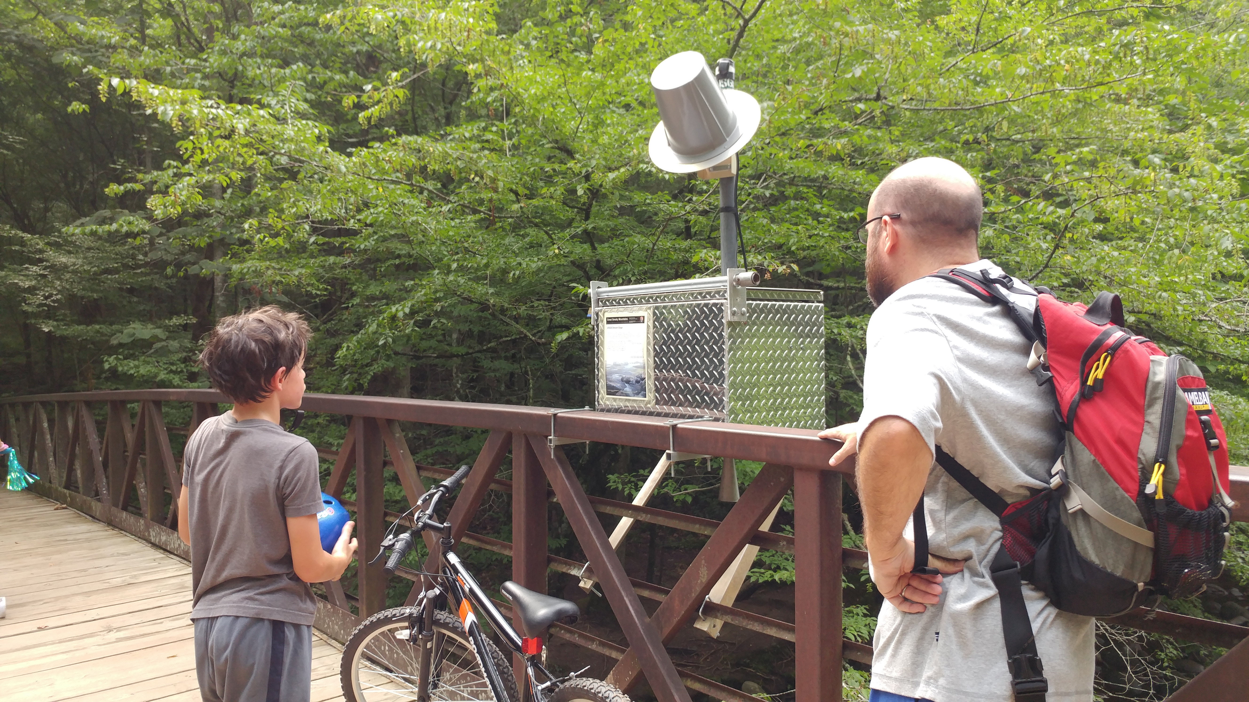 Dad and son looking at the river gage on Gatlinburg Trail.