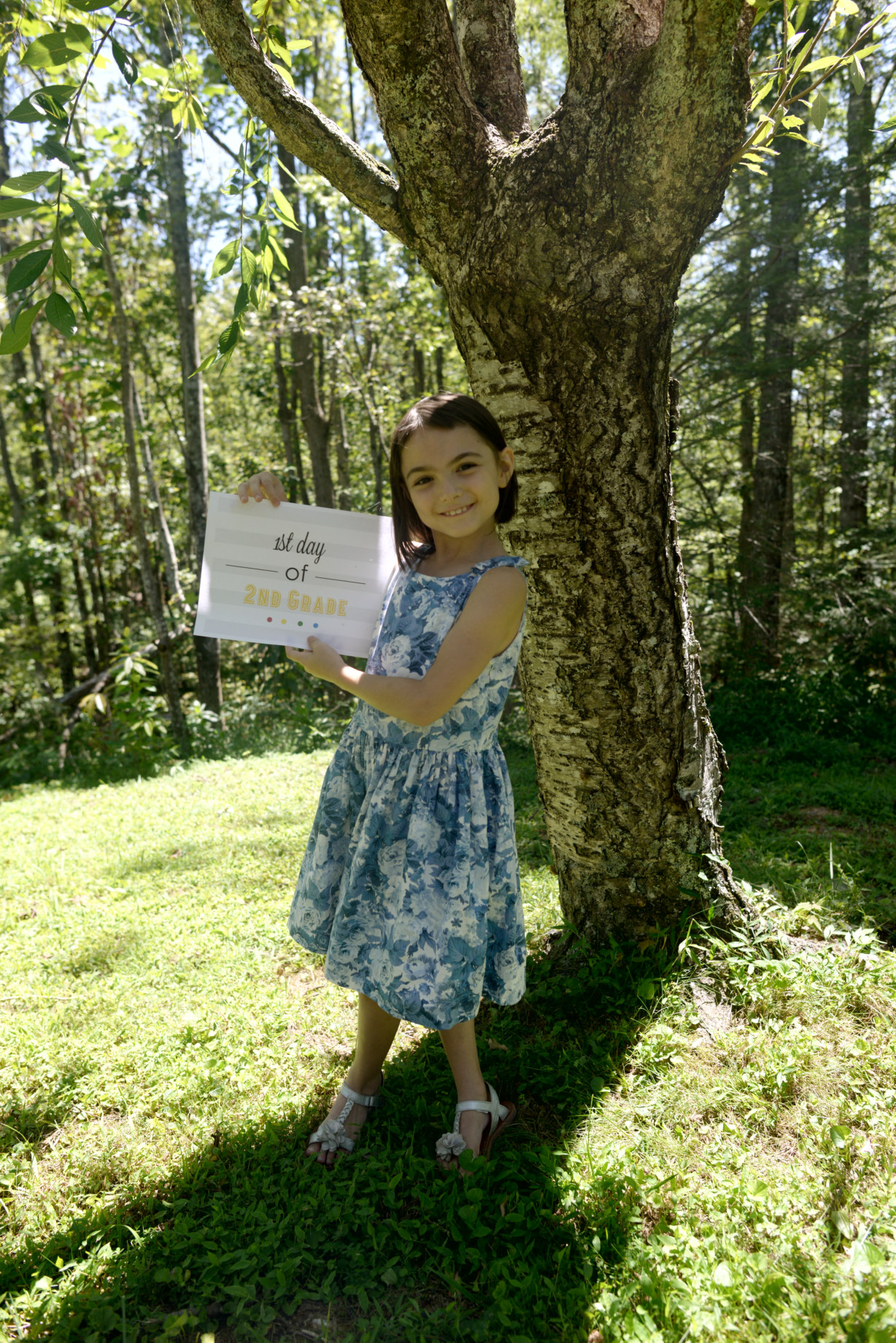 Girl holds sign for back to school