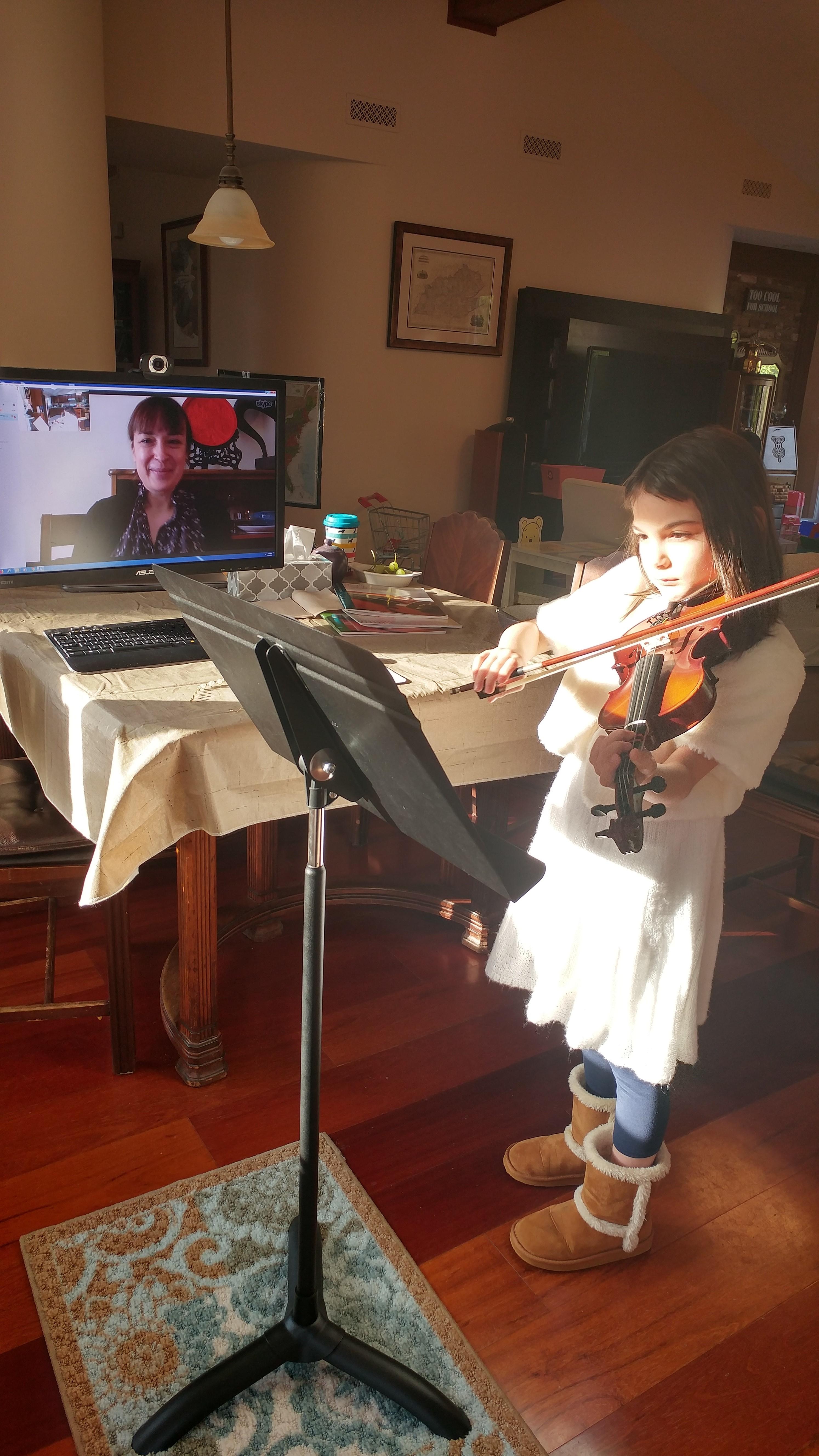 Girl taking Skype vioiin lesson