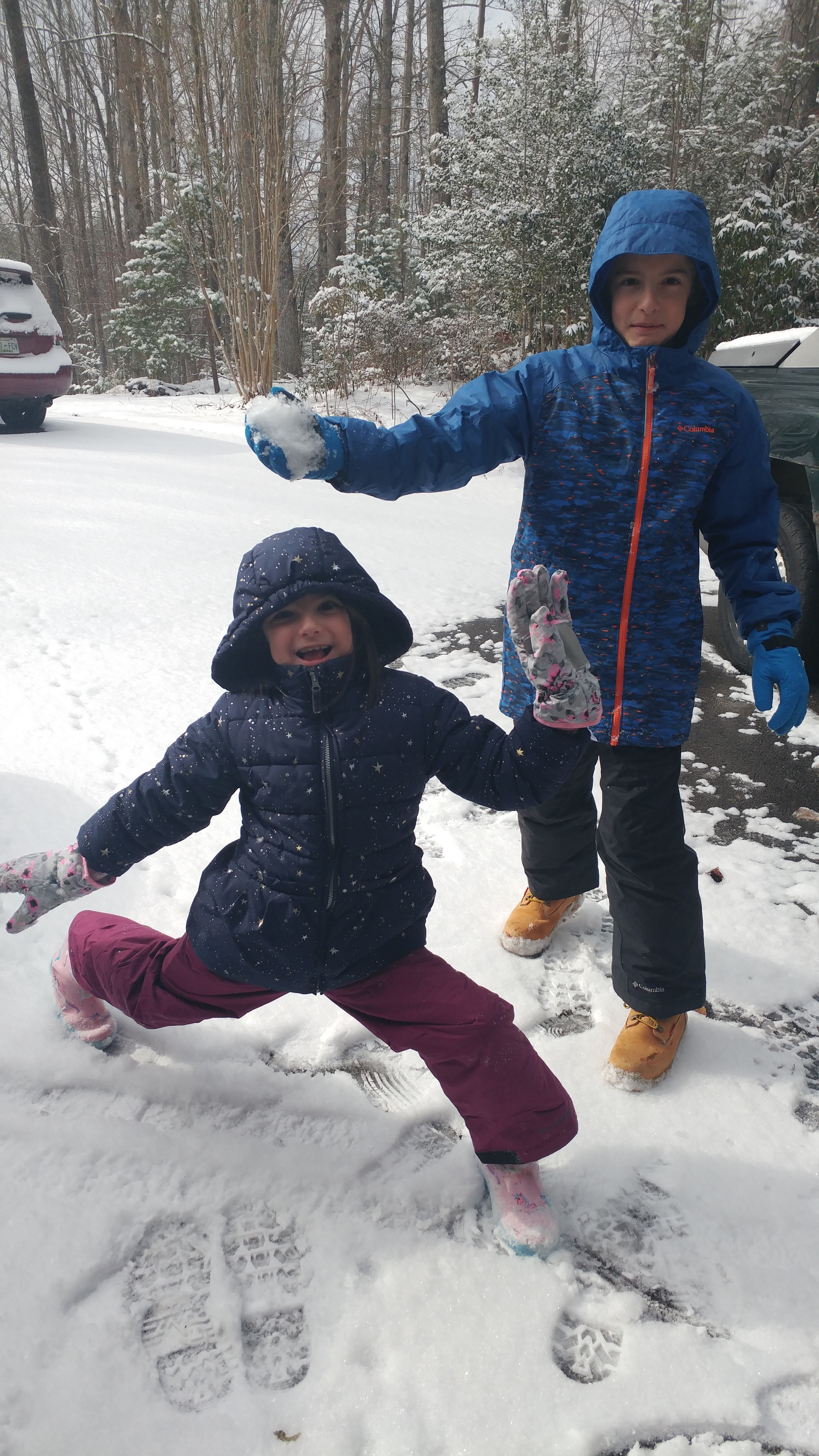 Boy and girl playing in the snow