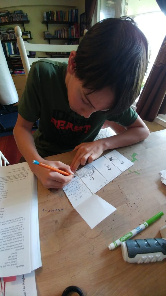 Boy writes in flip book